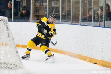 Boston Blades defender Sato Kikuchi (8) sends the puck around the back