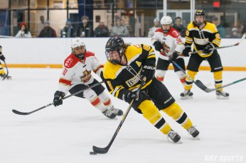 Boston Blades forward Erin Kickham (6) controls the puck for the Blades
