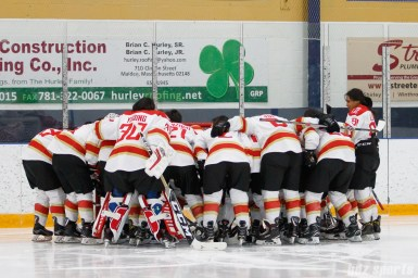 The Kunlun Red Stars huddle before the start of the game