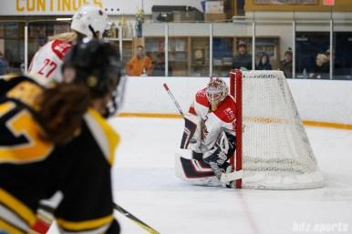 Kunlun Red Stars goalie Noora Raty (41) blocks an incoming shot
