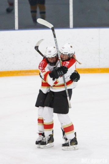 Kunlun Red Stars forward Kelli Stack (16) celebrates scoring a goal with teammate Zoe Hickel (44)