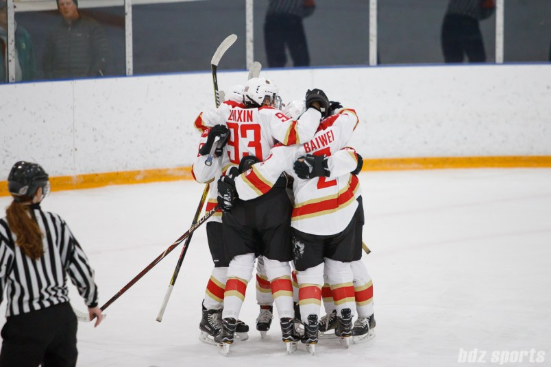 The Kunlun Red Stars celebrate teammate Kelli Stack's goal