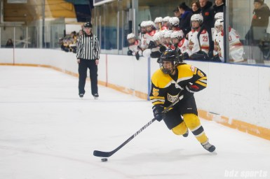 Boston Blades forward Michelle Ng (5) controls the puck for the Blades