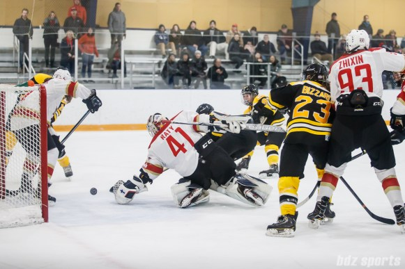 Boston Blades forward Taylor Wasylk (19) slips the puck past Kunlun Red Stars goalie Noora Raty (41) to score Boston's second goal of the game