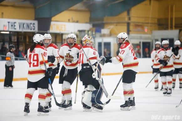 The Kunlun Red Stars congratulate goalie Noora Raty (41) after defeating the Boston Blades 4-2 on January 27, 2018