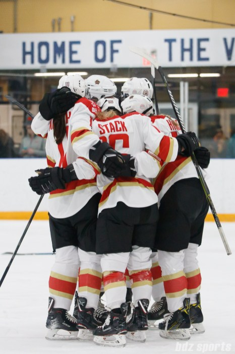The Kunlun Red Stars celebrate teammate Zoe Hickel's goal in the first period