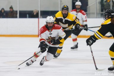 Kunlun Red Stars forward Kelli Stack (16) brings the puck up through the neutral zone