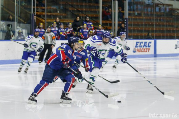 Team South Korea defender Chae Lin Park (15) looks to bring the puck out of Korea's defensive end