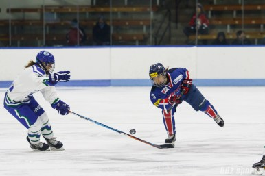 Team South Korea defender Su Yeon Eom (3) sends the puck down the ice