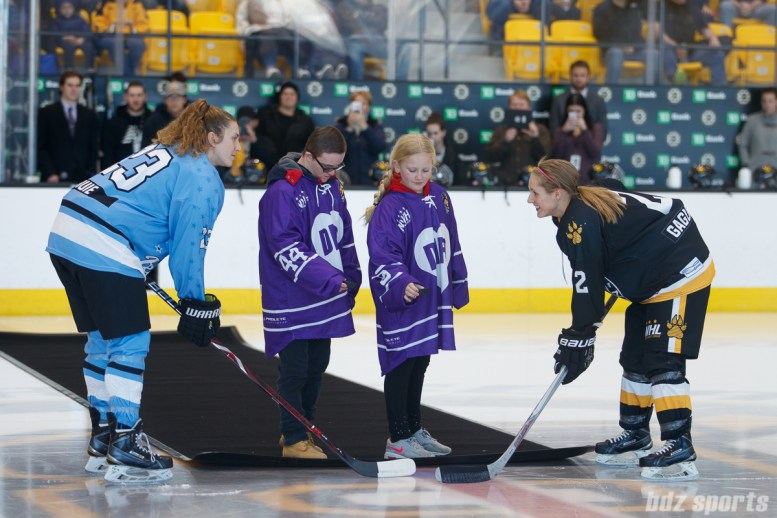 Buffalo Beauts forward Corinne Buie (23) and Boston Pride defender Alyssa Gagliardi (2) take the ceremonial puck drop