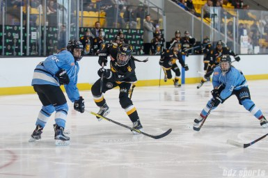 Boston Pride forward Sydney Daniels (19) takes a shot on the Buffalo Beauts' goal