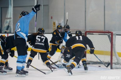 Buffalo Beauts forward Rebecca Vint (12) celebrates after scoring the Beauts' sixth goal of the game