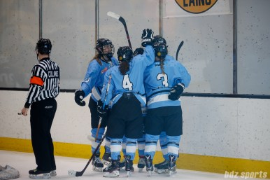 The Buffalo Beauts celebrate forward Rebecca Vint's (12) power play goal