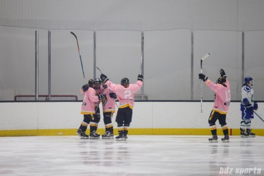 The Boston Pride celebrate forward Sydney Daniels' (19) second goal of the game