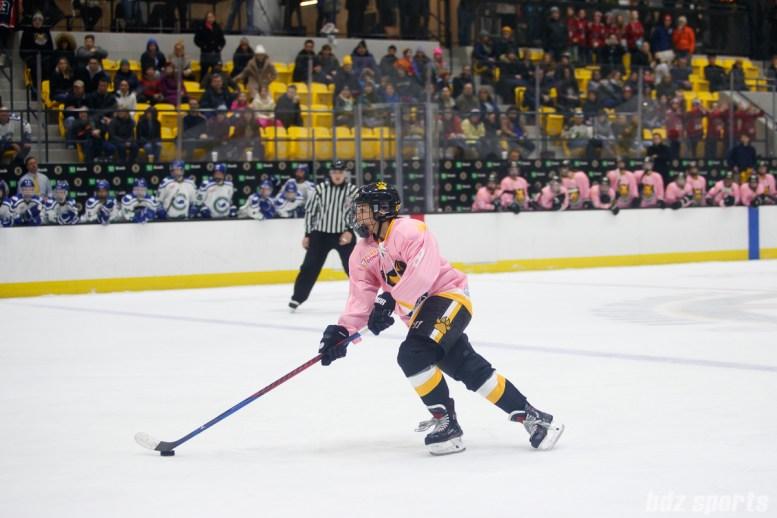 Boston Pride forward Dana Trivigno (8) skates up ice in the overtime shootout