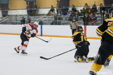 Boston Blades forward Megan Myers (15) blocks the shot from Kunlun Red Star defender Zhixin Liu (93)
