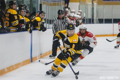 Boston Blades defender Sato Kikuchi (8) controls the puck for the Blades