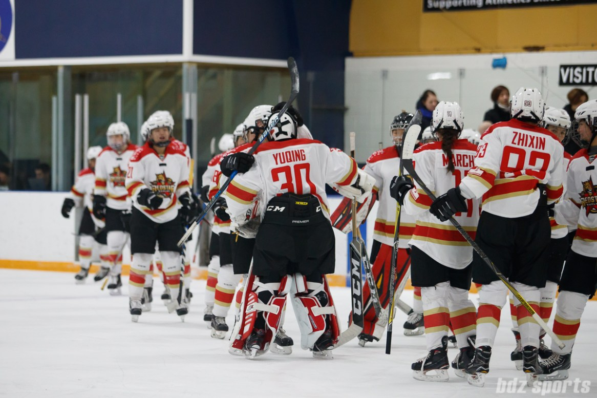 The Kunlun Red Star congratulate goalie Yuqing Wang (30) after the Red Stars beat the Blades 4-2.