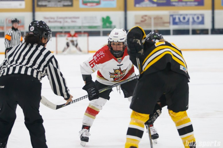 Kunlun Red Star forward Kelli Stack (16) prepares to take the faceoff
