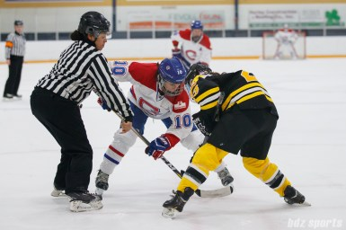 Montreal Les Canadiennes forward Noemie Marin (10) takes the faceoff against Boston Blades forward Courtney Turner (3)