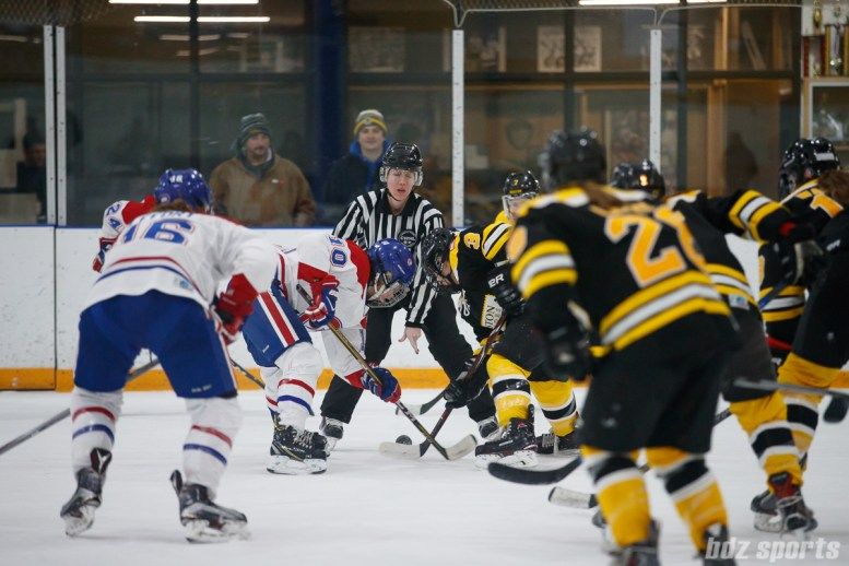 Montreal Les Canadiennes forward Noemie Marin (10) takes the face off against Boston Blades forward Courtney Turner (3)