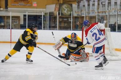 Boston Blades goalie Amanda Cariddi (1) makes a stop