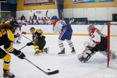 Boston Blades forward Melissa Bizzari (23) looks on after passing off the puck