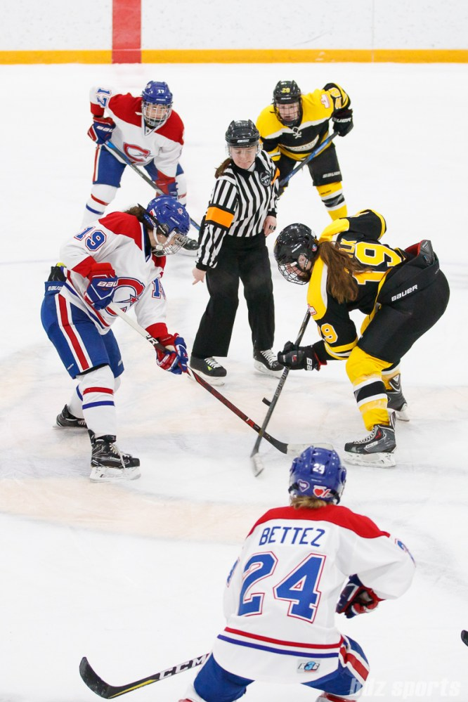 Montreal Les Canadiennes forward Katia Clement-Heydra (19) and Boston Blades forward Taylor Wasylk (19) take the face off to start overtime