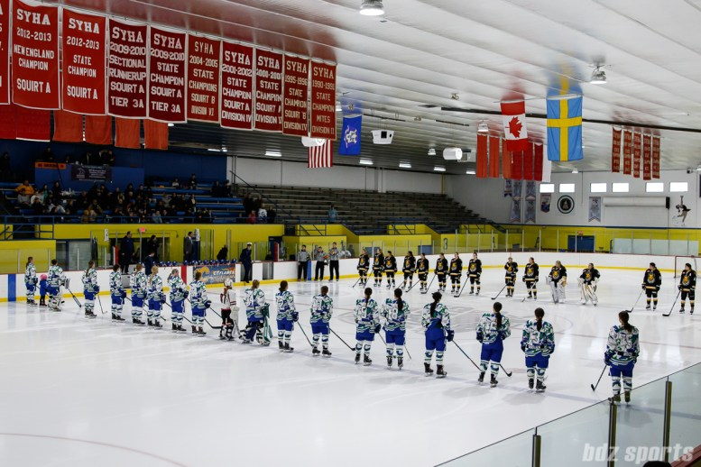 The Connecticut Whale and Boston Pride line up at the blue line for pre-game announcements