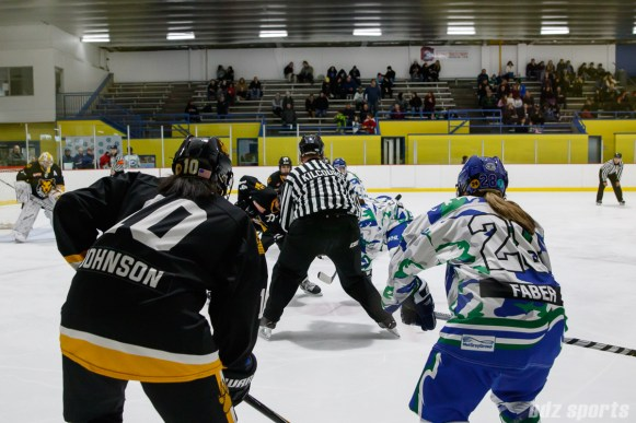 Boston Pride defender Kaliya Johnson (10) lines up against Connecticut Whale forward Sam Faber (28) on a face-off