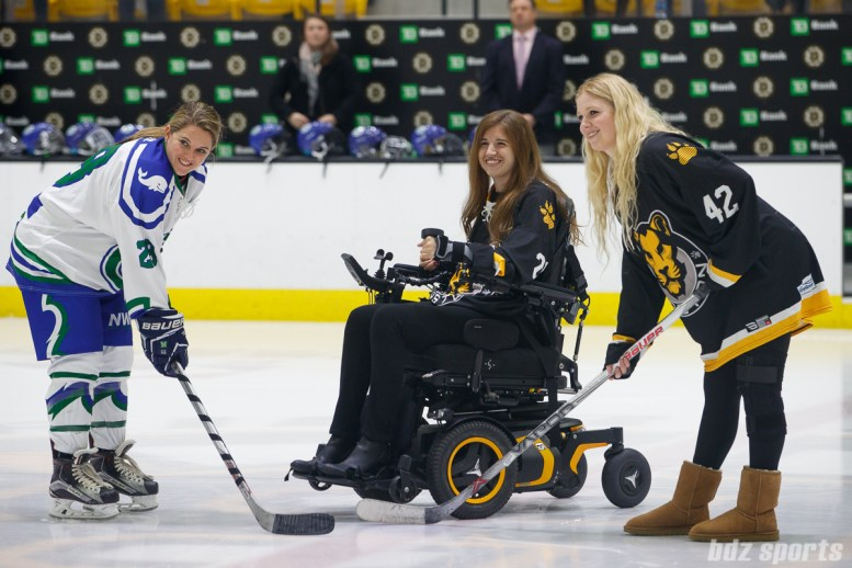 Boston Pride forward Denna Laing (24) drops the puck with Connecticut Whale captain Sam Faber (28) and Pride goalie Brianna Laing (42) prior to the start of the game