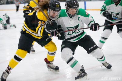 Boston Blades forward Meghan Grieves (17) and Markham Thunder defender Jocelyne Laroque (3)