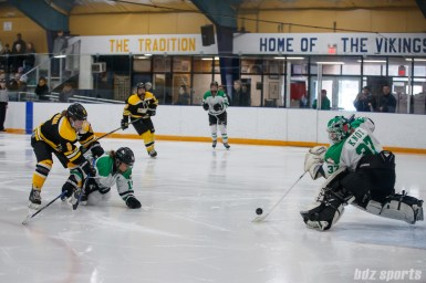 Markham Thunder goalie Elizabeth Knox (37) clears out the puck