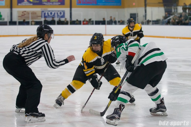 Boston Blades forward Courtney Turner (3) and Markham Thunder forward Nicole Kosta (22) take a face-off