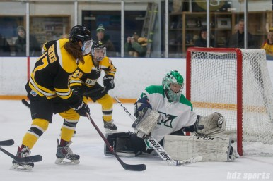 Markham Thunder goalie Elizabeth Knox (37) tracks the puck after a shot from Boston Blades forward Meghan Grieves (17)