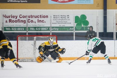 Markham Thunder forward Jamie Lee Rattray (26) takes on Boston Blades goalie Lauren Dahm (35) on a breakaway