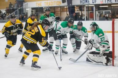 Boston Blades forward Casey Stathopoulos (12) takes a shot on net