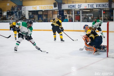 Markham Thunder forward Jamie Lee Rattray (26) takes on Boston Blades goalie Amanda Cariddi (1)