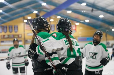 Markham Thunder forwards Laura Stacey (7) and Jenna McParland (91) celebrate Stacey's goal (McParland with the assist)