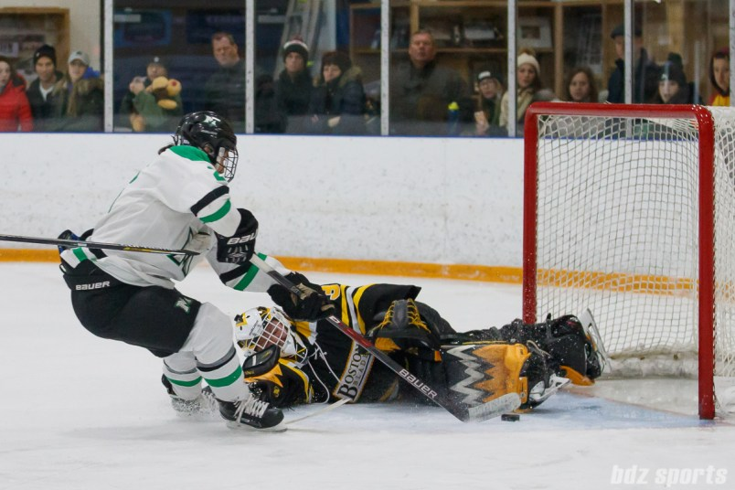 Markham Thunder forward Jamie Lee Rattray (26) slips the puck past Boston Blades goalie Lauren Dahm (35) to score the Thunder's second goal of the game