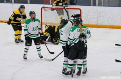 The Markham Thunder celebrate forward Kristen Richards' (9) goal