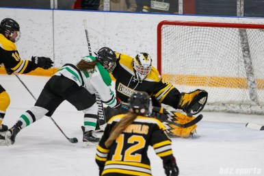Boston Blades goalie Lauren Dahm (35) keep the puck out of the net