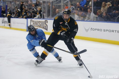 Boston Pride forward Janine Weber (26) controls the puck while being defended by Buffalo Beauts defender Jacquie Greco (25)