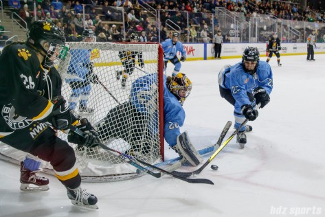 Buffalo Beauts goalie Amanda Leveille (28) and defender Jacquie Greco (25)