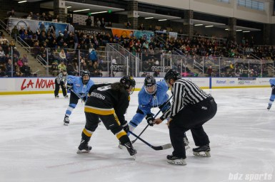 Boston Pride forward Dana Trivigno (8) and Buffalo Beauts forward Maddie Elia (16) take a face-off