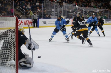Buffalo Beauts forward Taylor Accursi (95) looks on as her shot is pushed wide by Boston Pride goalie Brittany Ott (29)