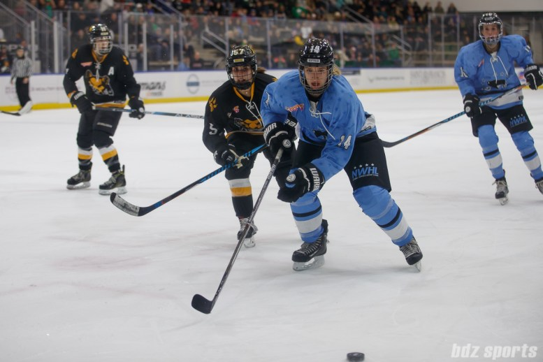Boston Pride defender Meagan Mangene (57) and Buffalo Beauts forward Hayley Scamurra (14)