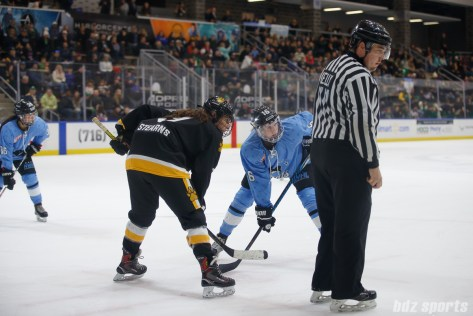 Boston Pride forward Corey Stearns (9) and Buffalo Beauts forward Maddie Elia (16)