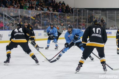 Buffalo Beauts forward Corinne Buie (23) takes on Boston Pride defender Paige Harrington (44)