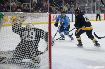 Buffalo Beauts defender Sarah Edney (3) looks on as her shot on goal finds the back of the Boston Pride net